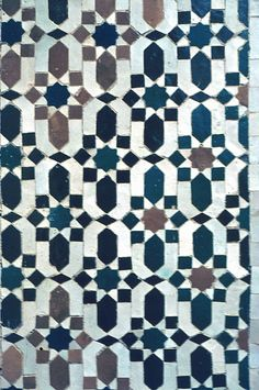 Image MOR 0901 featuring decorated area from the Bou Inaniya Medersa/Mosque, in Meknes, Morocco, showing Geometric Pattern using ceramic tiles, mosaic or pottery.