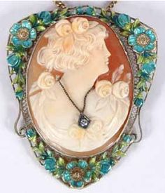 """Victorian shell cameo of woman adorned with flowers and diamond? necklace mounted in a 14k enamel floral and filigree pin/pendant. Pin clasp marked \""""14K\"""". 2\"""" tall. Very good condition. Sold as-is."""