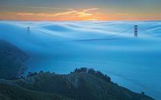 San Francisco, CA  Fog over Golden Gate Bridge.