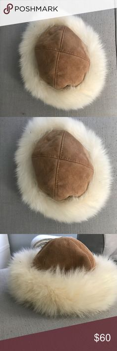 """Women's winter shearling hat Beautiful women's shearling lined hat. Fur trim around outside and inside full lined. Outside is tan suede. Purchase in boutique ski shop - excellent condition - roughly 21"""" diameter Accessories Hats"""