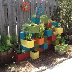 10 Fantastic Ideas For Decorating Your Patio or Garden Fence Our cinder block herb garden.they look so much better painted rather than just gray.also would look great all painted one color that coordinates with house color. Diy Art Projects, Outdoor Projects, Garden Projects, Simple Projects, Outdoor Decor, Garden Planters, Garden Beds, Concrete Planters, Cinderblock Planter