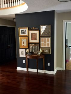 Benjamin Moore Wrought Iron gallery wall with gold frames