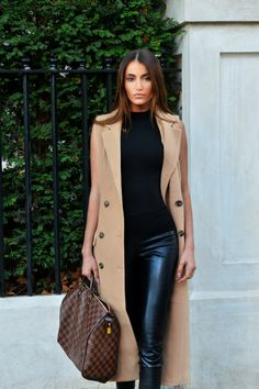 Camel double breasted sleeveless long coat, high waist black leather pants, black patent and suede heeled sneakers by Jimmy Choo & damier Louis Vuitton speedy handbag. Blogger, Maureen Sophie Kragt on her way to Brunch at the Mondrian located on London's famous Thames river. For more infos, visit www.thevanillawoods.com