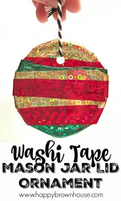 This Washi Tape Mason Jar Lid Ornament is adorable and so easy to make for Christmas. This homemade ornament idea is perfect for working on preschool fine motor skills. The best part is I already have all the mason jar lids and washi tape for this kids Christmas craft activity.