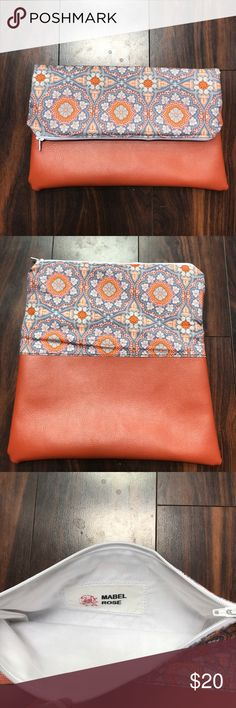 """Orange fold over clutch Faux leather bottom with an orange patterned top. Zipper closure. 6""""X10"""". This items is handmade by me. Mabel Rose Bags Clutches & Wristlets"""