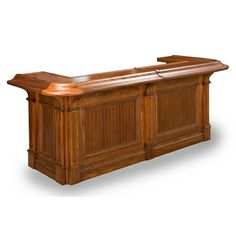 The Hillsborough Bar is a top-of-the-line straight bar for your entertainment space. It has rounded corners and unique detail carved under the bar top, as well as convenient shelving in the back of the bar to store your accessories. #dannyveghs #custombars