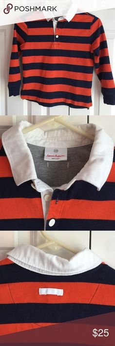 Hanna Andersson Striped Rugby Size 120 - navy blue and orange striped rugby polo. Excellent condition - normal wear and tear. No stains, rips or tears. Smoke free home. Hanna Andersson Shirts & Tops Polos