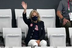 Athletes on U.S. swimming team chant 'Dr. Biden' for First Lady as she watches the Olympics Saturday | Daily Mail Online Team Chants, Cheers And Chants, Jill Biden, Swim Team, Farm Hero Saga, Mail Online, Daily Mail, Athletes, Olympics
