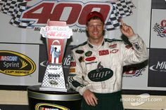 Nascar winner Dale Earnhardt, Jr. with finished Lifelock 400 trophy from my design.