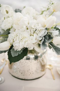 This is a good image of the white flowers with dusty miller, a foliage that would be good to have in your centerpieces.