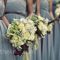 green and white bouquets of roses, kale, hydrangeas, dusty miller, silver brunia, seeded eucalyptus, and begonia leaves