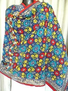 This gorgeous phulkari work georgette dupatta has a unique color combination, and heavy embroidery. It has been hand embroidered in a vibrant colored floral pattern, with wool thread and sequins. - See more at: http://giftpiper.com/HandmadePhulkariWorkGeorgetteDupatta-NavyBlue-id-536225.html#sthash.YyVZvHTJ.dpuf