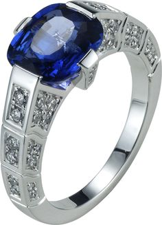 Engagement ring in white gold, diamonds and a cushion-cut blue sapphire