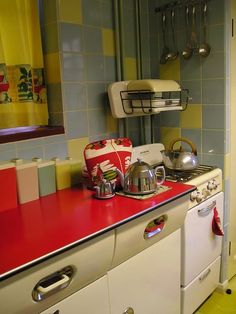 1950s Timewarp Kitchen. Covet those metal cabinets! My mum still has these English Rose units in her kitchen.