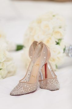 Christian louboutin heels make every bride feel like they are wearing Cinderella's glass slippers