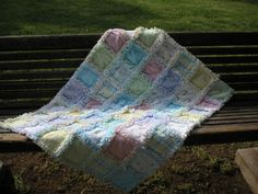 Made from packaged flannel receiving blankets chosen by the mom for her baby's shower registery.