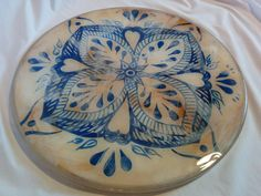 Handpainted mexican style table top embedded with epoxy resin.