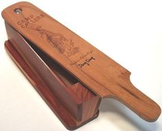 The call is a simple wooden box with a paddle for a top that, when moved back and forth over the walls of the box, simulates the gobble or squawk of the bird