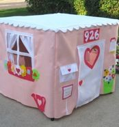 Get your own property value increase with these card table playhouses. Make your own with scrap fabric, felt and hot glue and the get your little decorators inside!