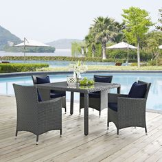 Sojourn 5 Piece Outdoor Patio Sunbrella(R) Dining Set, Canvas Navy - Outfit your patio with an imaginative outdoor sectional series of exceptional quality. The Sojourn series offers a robust seating experience that easily rearranges according to usage. Outfitted with industry-leading Sunbrella(R) fabric cushions, synthetic rattan weave, UV protection, powder-coated aluminum frame, immensely enjoy your outdoor time with a series that enhances patio, backyard or poolside areas. This…