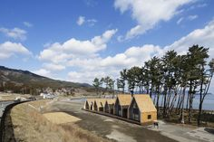 Completed in 2015 in Japan. Images by Koji Fujii. This is the assembly hall for the area damaged by the Great East Japan Earthquake. A small complex facility containing tenant shops for surf shops, cafes, etc., and an assembly hall were planned at NAMIITA Coast, OTSUCHICHO, IWATE Prefecture, used to be busy location as the Mecca of surfers in the past.