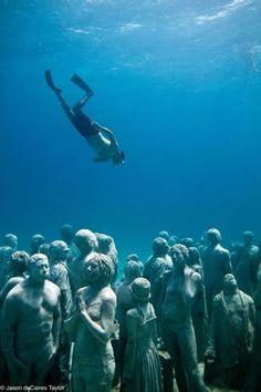 Jason deCaires Taylor   La Evolución Silenciosa (The Silent Evolution)  400 life-size figures. Depth 9m Cancun / Isla Mujeres, Mexico.