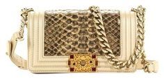 Chanel Python Boy Shoulder Bag. Get one of the hottest styles of the season! The Chanel Python Boy Shoulder Bag is a top 10 member favorite on Tradesy. Save on yours before they're sold out!