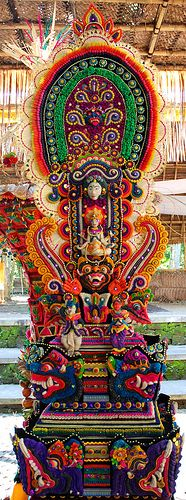 A Pillar for the Gods by Caneles o Flickr - This is a altar in offering to the Gods in the Hindustani temple in the monkey forest in Ubud, Bali. Big parts of the pillar are made from food, fat and flowers