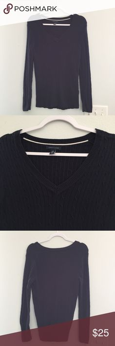 Women's Dark Navy Tommy Hilfiger sweater NWOT Women's Dark Navy V-neck sweater. Simple cable knit pattern throughout with a Tommy logo featured on the left wrist cuff. 100% cotton. NWOT. Tommy Hilfiger Sweaters V-Necks