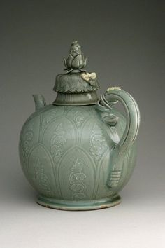 Ewer with cover  First half of the 12th century  Korean  Goryeo Dynasty  Stoneware with underglaze slip decoration and glaze  (source)
