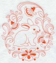 A bunny inside a circle of flowers in Redwork.