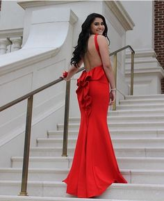 """Red is the color of 'wow"""" and @tammann certainly wowed at her prom this spring!  Headed to prom this weekend? Don't forget to tag your photos with #DavidsProm for a chance to be featured, too!  And for more of this dress, tap the link in our profile!"""