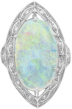 Edwardian Platinum, Opal and Diamond Ring One oval opal ap. 4.50 cts., c. 1910, ap. 4.7 dwt. Via Doyle New York.