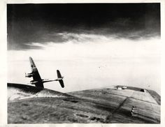 """1944- You are looking out of an American Flying Fortress, B-17 """"Lady Godiva"""", at a Nazi Messerschmitt less than 25 feet off the bomber's wing just as the fighter pulls away to start dive. Photo made by aerial combat photographer Victor LaBruno during U.S. 8th Air Force raid on oil plants at Brux."""