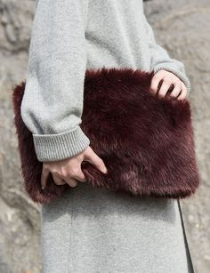 Burgundy faux fur clutch with zipper opening. Fully lined. *100% Faux Fur*Measures 15.5