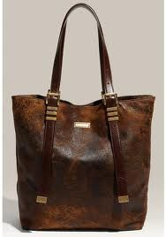 Michael Kors - I love that it has that already beat up look :)