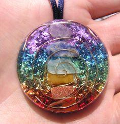 7 Chakras Orgone Crystal Healing Pendant by mysticrocksorgone on Etsy https://www.etsy.com/listing/89488200/7-chakras-orgone-crystal-healing-pendant