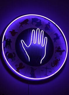 purple neon hand by john fullard, via Flickr