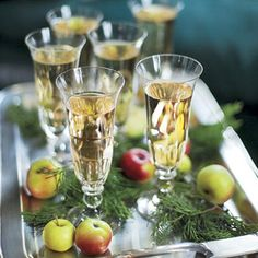 Crabapples adorn a serving tray of Champagne for toasting.