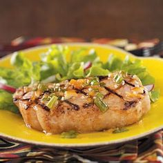 """Cajun Orange Pork Chops Recipe -""""My husband and I are busy and calorie-conscious. This dish is quick, delicious and easy on the waistline."""" Plus, it's bursting with flavor! Patricia Harmon - Baden, PA"""