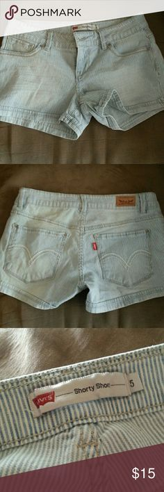 Levi's stripped short shorts! Denim and white stripes. Levi's shorts in great condition! Only worn once. Size 5 but fits like a small or medium. Levi's Shorts Jean Shorts