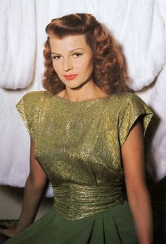 Rita Hayworth. Great lipstick: orange-tinted red