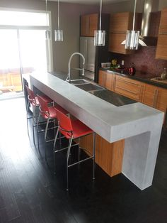 """Concrete counter-top designs have become the catalyst of many a kitchen makeovers, becoming a """"household"""" word in the design circles Kitchen Gallery, Fireplace Surrounds, Concrete Countertops, Kitchen Design, Household, Kitchens, Table, Furniture, Home Decor"""