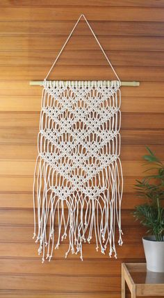 This wall hanging is made from natural 4mm cotton cord and is roughly 40cm wide and 90cm long.  Ideal for small wall spaces and a simple yet stylish design. The same pattern can also be made into a larger size and used for a curtain or bed head. Please note that the hanging does not include the dowel (for easier shipping). You are welcome to mount it on a cord, dowel or pipe of your choice.  If you prefer to customise this design and have it made in a different size, colour or with different…