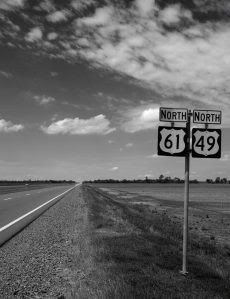 'Blues Highway' intersection of Highways 61 and 49—the crossroads, legend claims, where aspiring blues musician Robert Johnson sold his soul to the devil in exchange for the prodigious guitar-playing skills he acquired. Highway 61 carried poor rural musicians and sharecroppers out of the dusty Mississippi cotton fields in the 1930s and '40s north towards Memphis and St. Louis, where audiences first clamoured for the raw, emotional singing and guitar playing that emerged from the Jim Crow…