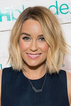 Lauren Conrad with a wavy bob, liquid liner, and soft pink cheeks and lips on February 5.