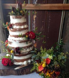4 tiered naked wedding cake. Cake designed by Flowers by the Bunch