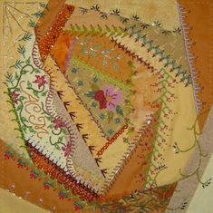 A Crazy Amish Quilt Free sewing pattern, with instructions and photo, showing how to make a crazy quilt pillow from scraps of fabric.