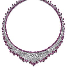 A Ruby and Diamond Necklace via Sotheby's. | The fine supple mesh of bib design, set with rose-cut diamonds to an inner line of circular-cut rubies, the edges trimmed with similarly cut and oval rubies of various sizes.