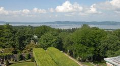 Panoramic view of the Hudson River from the 1913 Classical Revival Georgian mansion Kykuit, home of the prestigious Rockefellers, in Tarrytown, NY. Tour the house (including the incredible modern art collection and gallery with Picassos) and gardens.